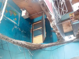 Scene of a partially collapsed  building which houses Brain Star Academy at No 30 Ajose Street, Okokomaiko,  on Tuesday, in Lagos.