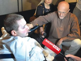Canavero (right) with Valery Spiridonov, who has volunteered for the first human head transplant. Photo: rex