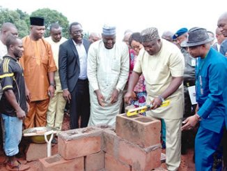 Governor Ifeanyi Ugwuanyi laying foundation stone for Specialist Hospital, Orba, to enhance health sector in the state.