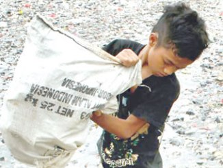 Boy emptying pet bottles in a river. PHOTO: CNN