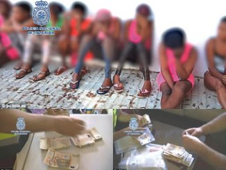 Some of the girls with the money recovered from them by the  Spanish police