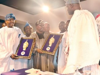 From left, President Egbe Omo Yoruba, North America, Mr Bolu Omodele; secretary Dr Duro Akindutire and the Ooni of Ife, Oba Adeyeye Enitan Ogunwusi during the visit of the group to the monarch.