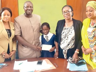 Oyo State Commissioner for Education, Science and Technology, Professor Adeniyi Olowofela (second left), presenting a cheque of N.1million to Miss Yetunde Lawal (middle), in Ibadan, on Tuesday. With him are Special Adviser to the governor on Education, Dr Bisi Akin Alabi (left); her Senior Special Assistant counterpart, Mrs Bolatito Adebisi and the Permanent Secretary in the ministry, Mrs Aderonke Makanjuola.