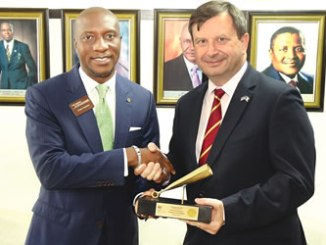Oscar N. Onyema, OON, Chief Executive Officer, NSE, left and Paul Thomas Arkwright, British High Commissioner to Nigeria, at the Closing Gong Ceremony at the Exchange.