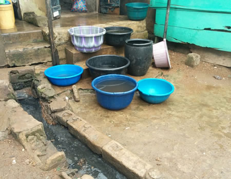 Beside the gutter are the bowls used in collecting water for drinking.