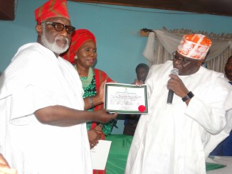 Ondo State governor-elect, Barrister Rotimi Akeredolu, of the All Progressives Congress (APC), receiving his Certificate of Return as the winner of the Ondo State Governorship election held on Saturday, November 26, 2016