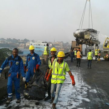 Road workers clearing the debris from the road. PHOTO: SYLVESTER OKORUWA
