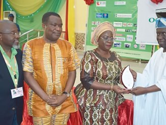 From right: Deputy, President, Lagos Chambers of Commerce and Industry (LCCI), Babatunde Runwase presenting a plaque to Deputy Governor, Ogun State, Yetunde Onanuga; Commissioner for Commerce and Industry, Ogun State, Abimbola Ashiru and Vice-President/Chairman, Trade Promotion Board, LCCI, Sola Oyetayo, at the Ogun State Special Day, held at the on-going 2016 Lagos International Trade Fair held on Tuesday in Lagos. Photo: Sylvester Okoruwa.