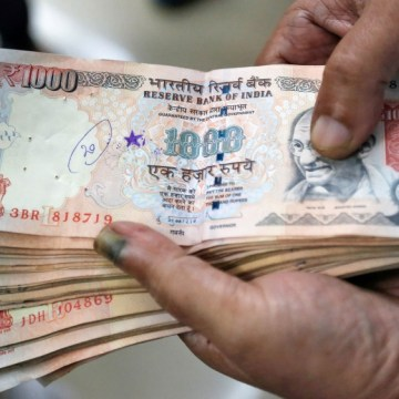 New 500 and 2,000-rupee denomination notes will be issued later, Modi said. PHOTO: REUTERS