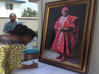 Co-chairman, African Newspapers of Nigeria (ANN) Plc, Ambassador Olatokunbo Awolowo Dosumu, signing the condolence register at the home of Sir Olaniwun Ajayi, Isara-Remo, Ogun State, on Friday. Photo: Olayinka Olukoya.