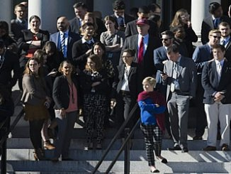 White House staff await the arrival of US president-elect Donald Trump for a meeting with US President Barack Obama at the White House, on Thursday. Photo: AFP.