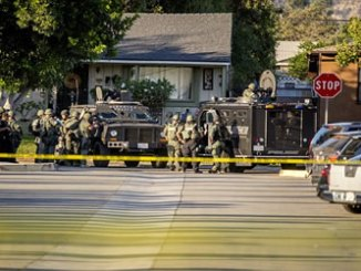 Azusa police chief, Steve Hunt, said the suspect is a female armed with a semi-automatic assault rifle and had barricaded herself into a residence.