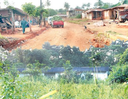 Inside Eti-Oni community. INSET: The community's clinic which is no longer useful