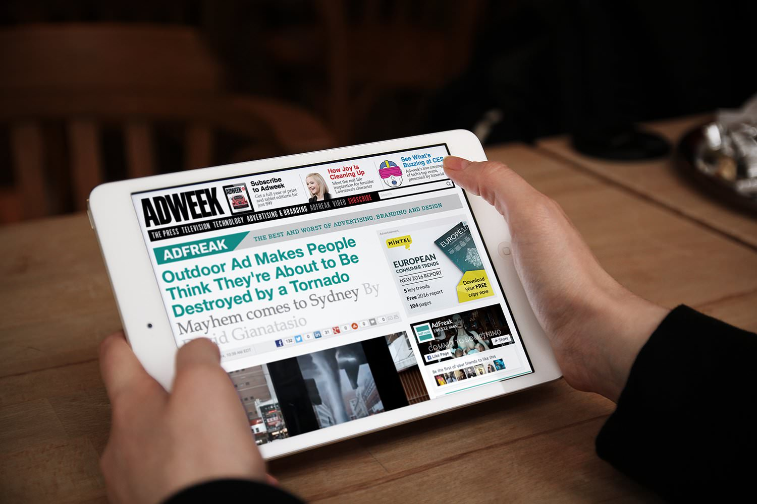 A tablet screen displays an article about a Grand Visual project on the AdWeek website – Tribus Creative – marketing and PR for small business