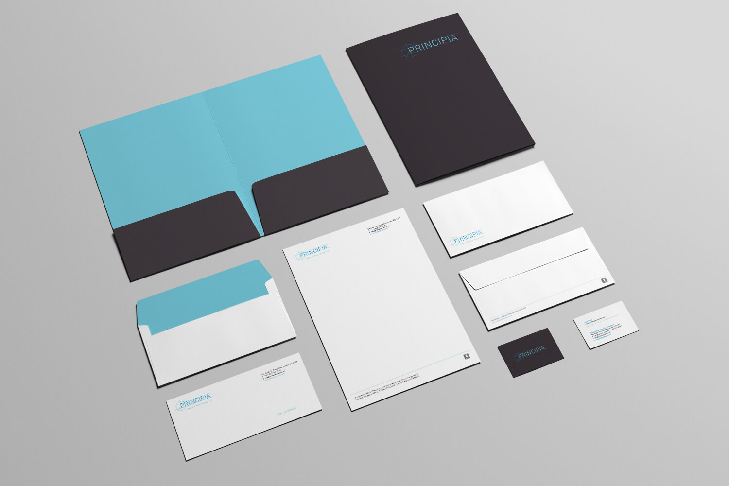 A photo of stationery that forms part of the new Principia brand identity design