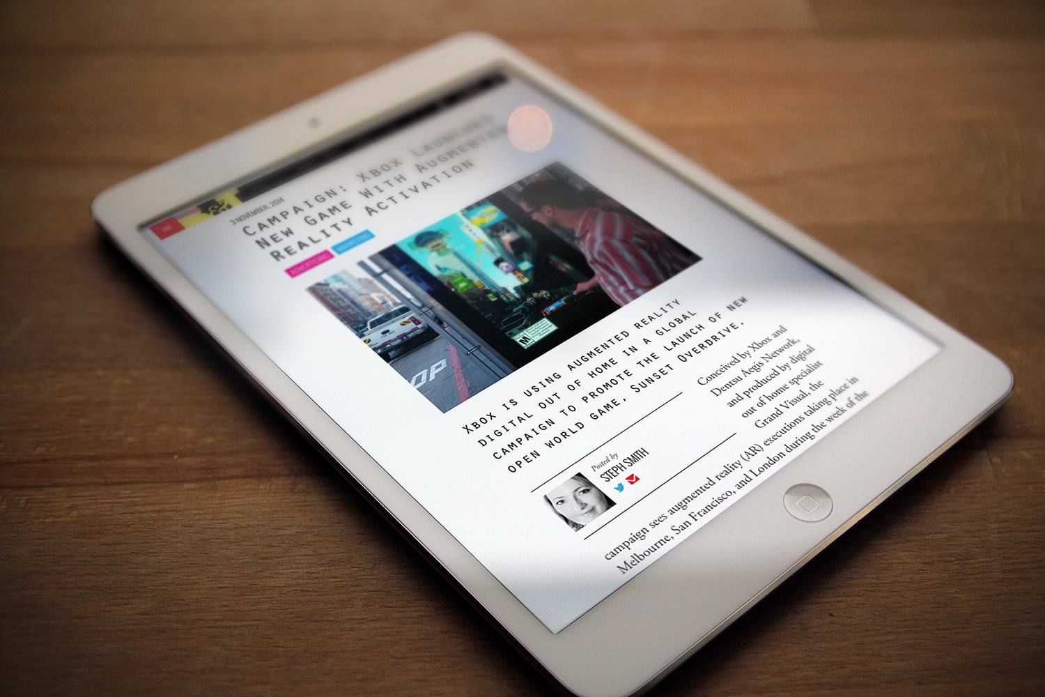 A tablet displaying an article on B&T regarding an Xbox campaign produced by Grand Visual – Tribus Creative – marketing and PR for small business