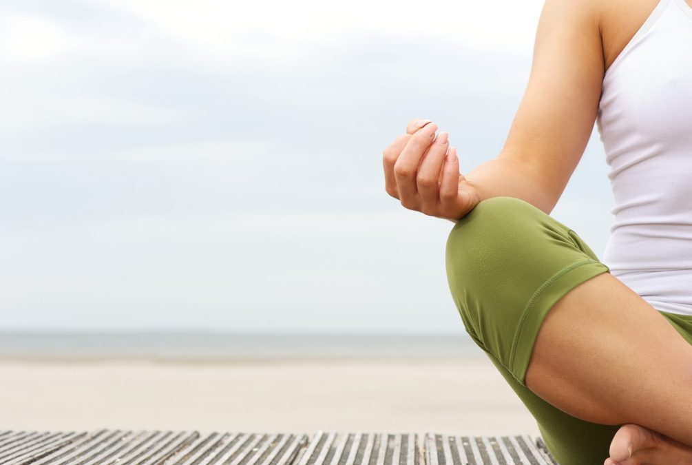 Portrait Of Female Yoga Hands At The Beach