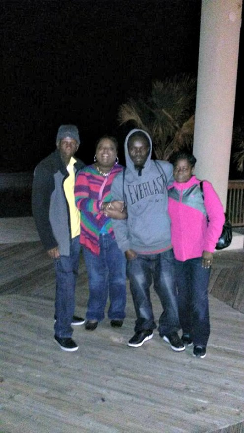 Dad, sister-in-law, bro and Mom pause for a pic in the cold