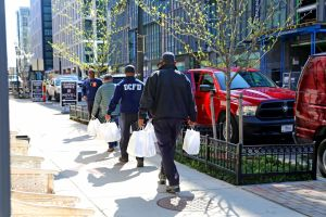 D.C. firefighters deliver meals as part of the Power of 10 Initiative.(Power of 10)