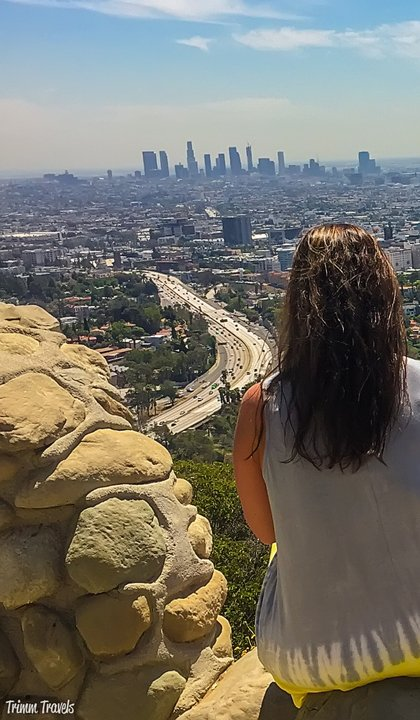 Me sitting on a rock overlooking downtown Los Angeles California and the 101 Freeway