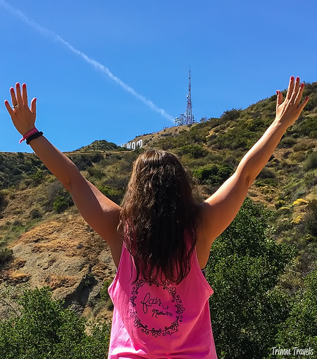Me looking up at a glimpse of the Hollywood Sign while hiking part of the way up Mount Lee Los Angeles California