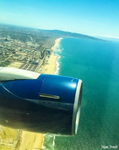 Aerial shot flying out of Los Angeles California over the beach and the Pacific Ocean