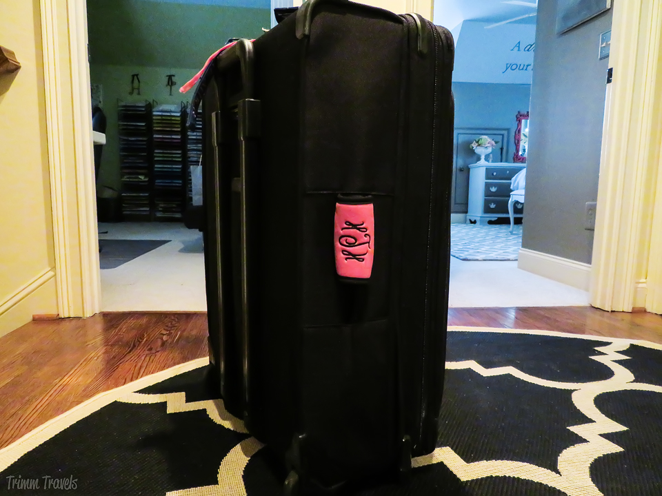 black suitcase standing up-tips for easy packing process