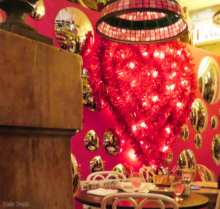 giant red, lit up garland type heart hanging on back wall of Serendipity 3 in New York City