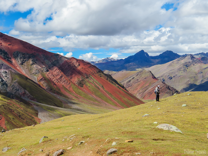 red and green mountains on the way down from Rainbow Mountain Peru