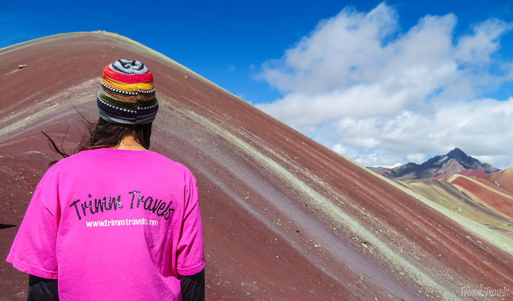 me from the back looking at Rainbow Mountain Peru
