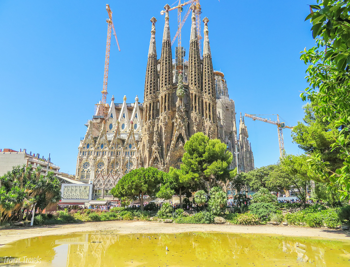La Sagrada Familia from the park with dried up pond in front A Gaudi Barcelona Tour