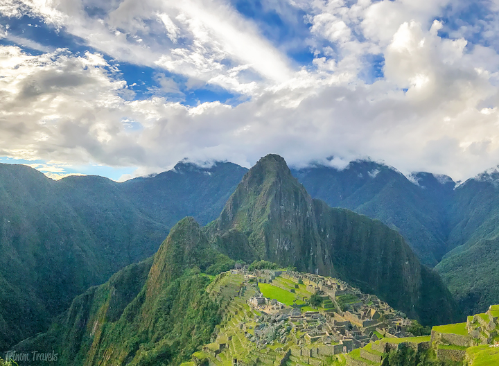 entire view of machu picchu peru with blue sky and sun
