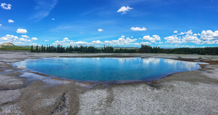 blue geothermal pool in yellowstone