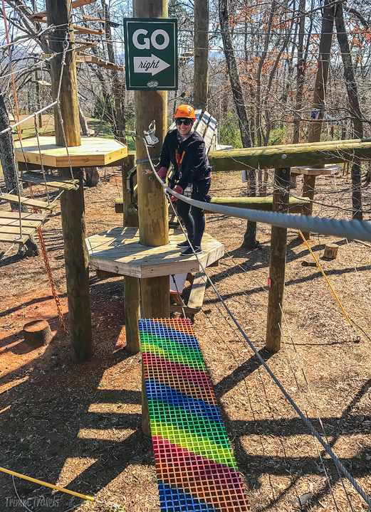 my friend Heather on the Rainbow Bridge obstacle course