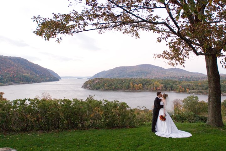 Wedding photo with water background at The United States Military Academy at West Point in New York