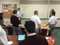 Members of Build discussing the designs of the robot