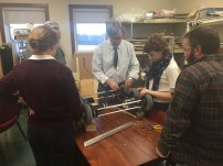 Build members working on the drive train
