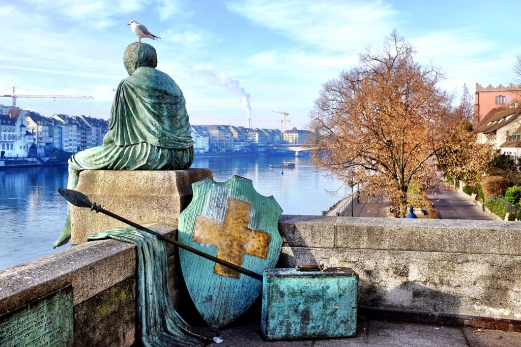 Things to do in Basel - Helvetia thinks about her travels at the border of the Rhein in Basel