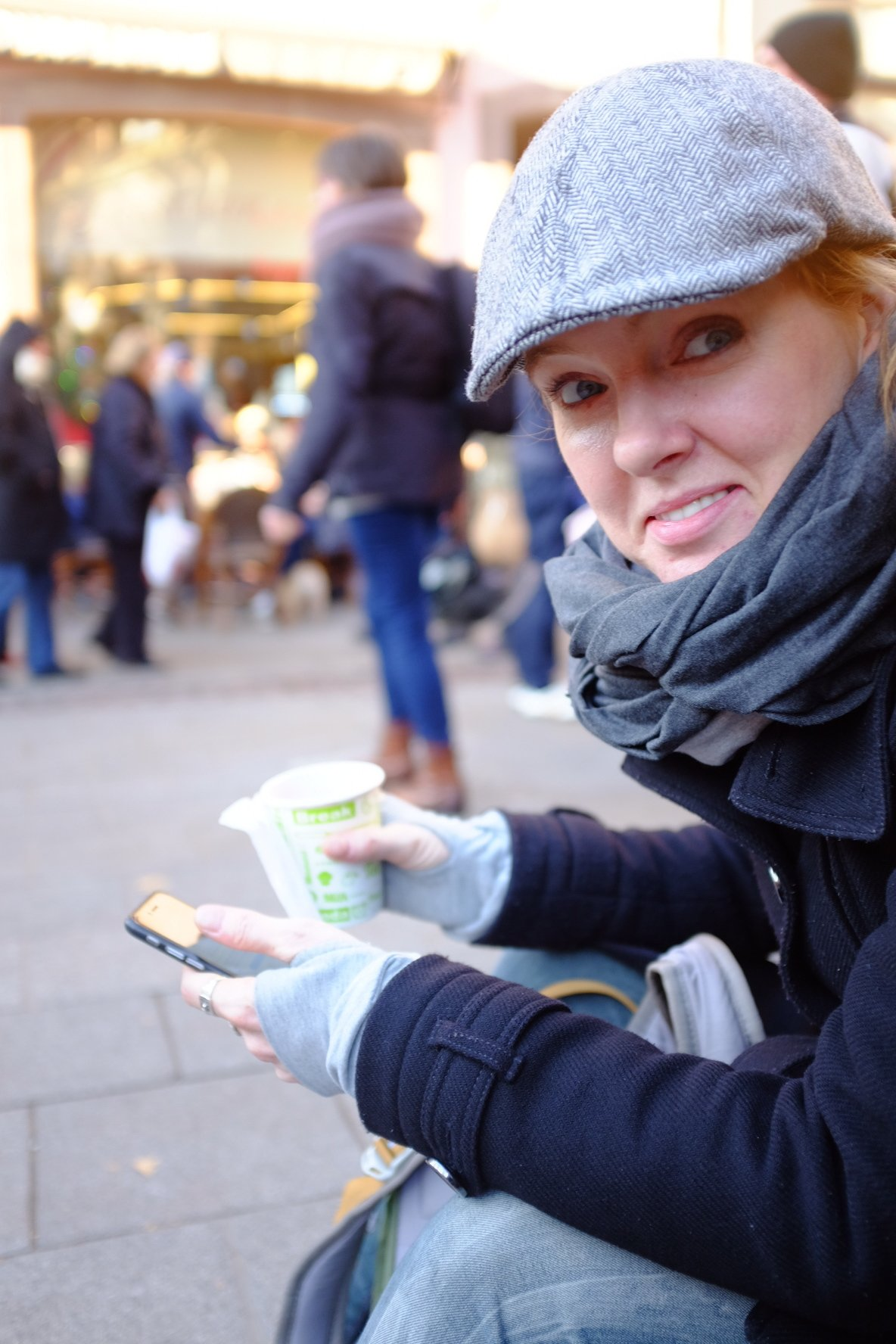 Sarah holding mulled wine at Christmas markets in Strasbourg