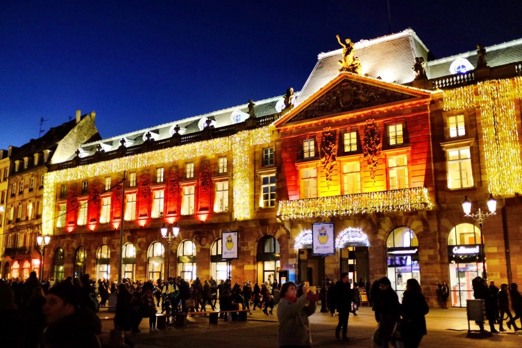 The town hall in Strasbourg is decorated with many small lights and shines at the Christmas markets in Strasbourg