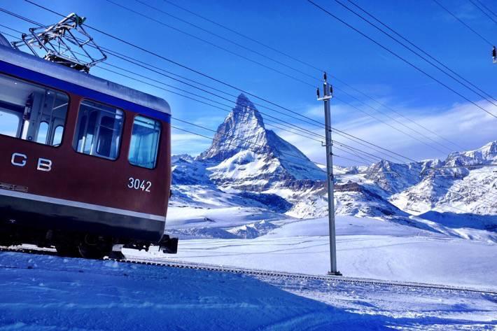 The Gornergrat cog railway and the Matterhorn in the background. Near Zermatt