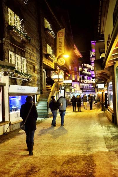What to do in Zermatt - Night shopping streets lamps illuminated