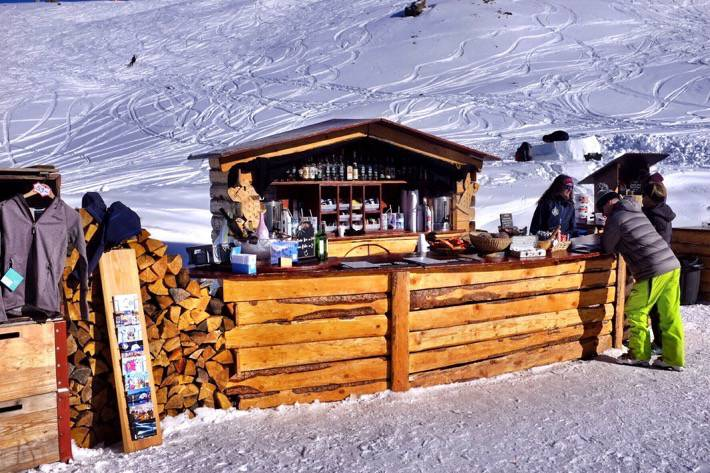 A wooden bar build in the snow in Zermatt