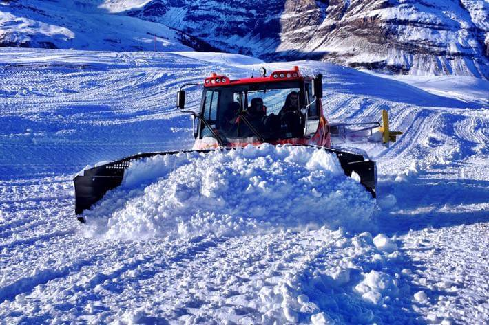What to do in Zermatt - A red snow plow preparing the ski pists in Zermatt