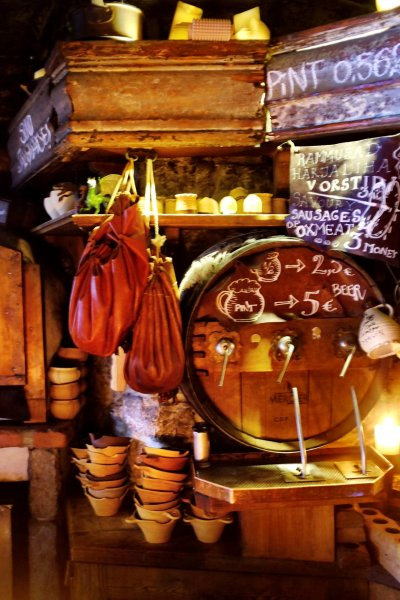 Tallinn city break The Draakon interior with a barrel, some ceramic bowls, some bags and the menu written all over the place. Situated in Tallinn