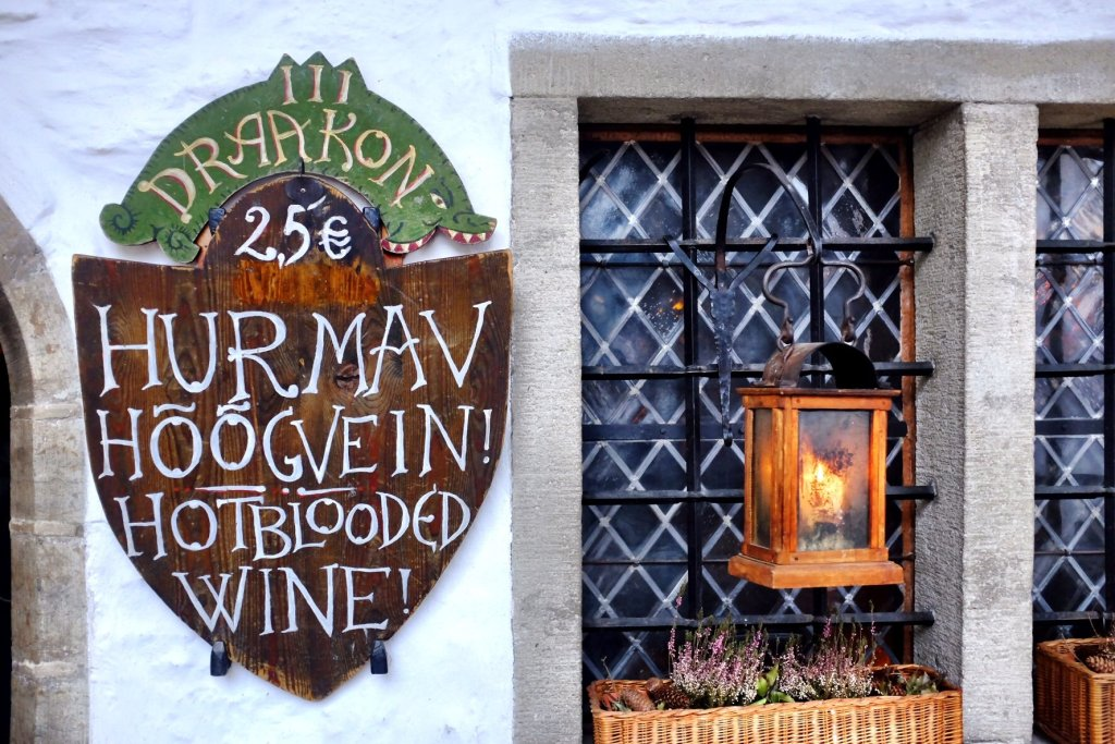 A shield outside of the Draakon Pub in Tallinn which advertises Hotblooded Wine