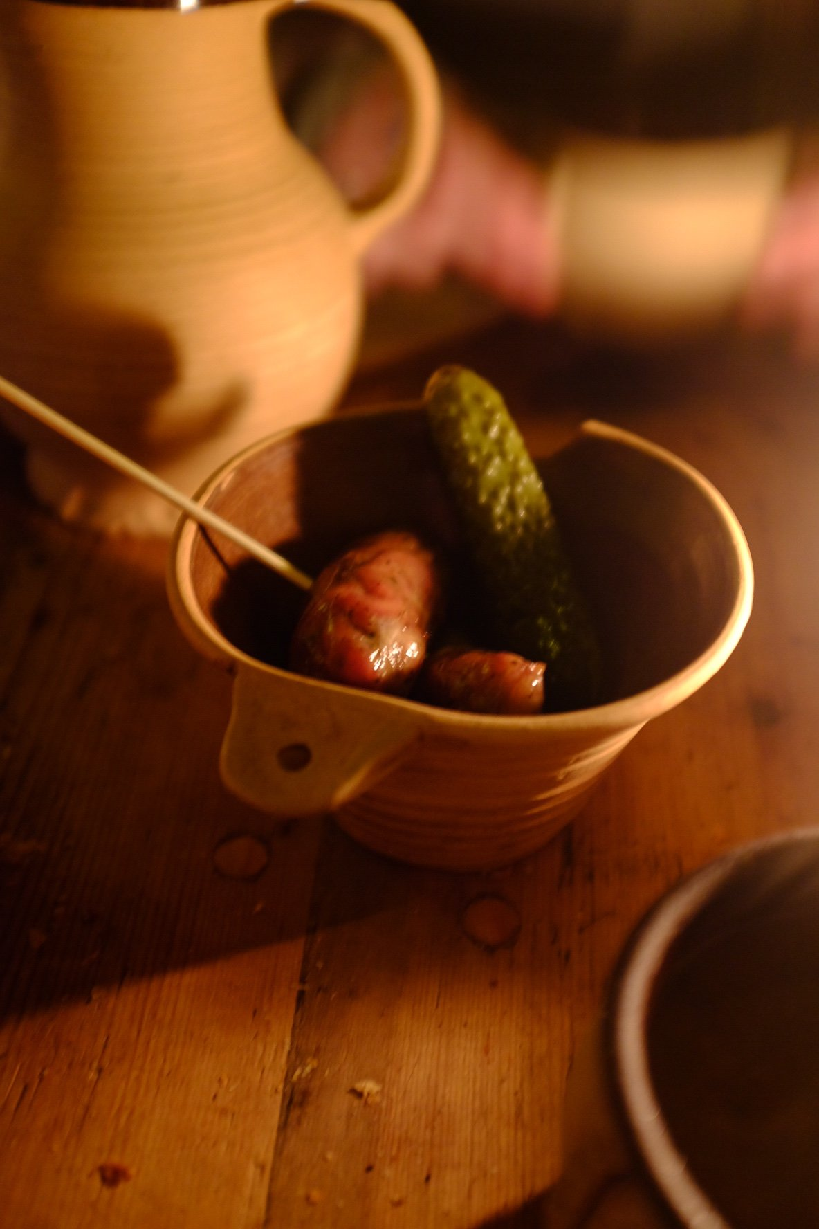 Ox sausage and pickle in a ceramic bowl we ate in the Draakon in Tallinn
