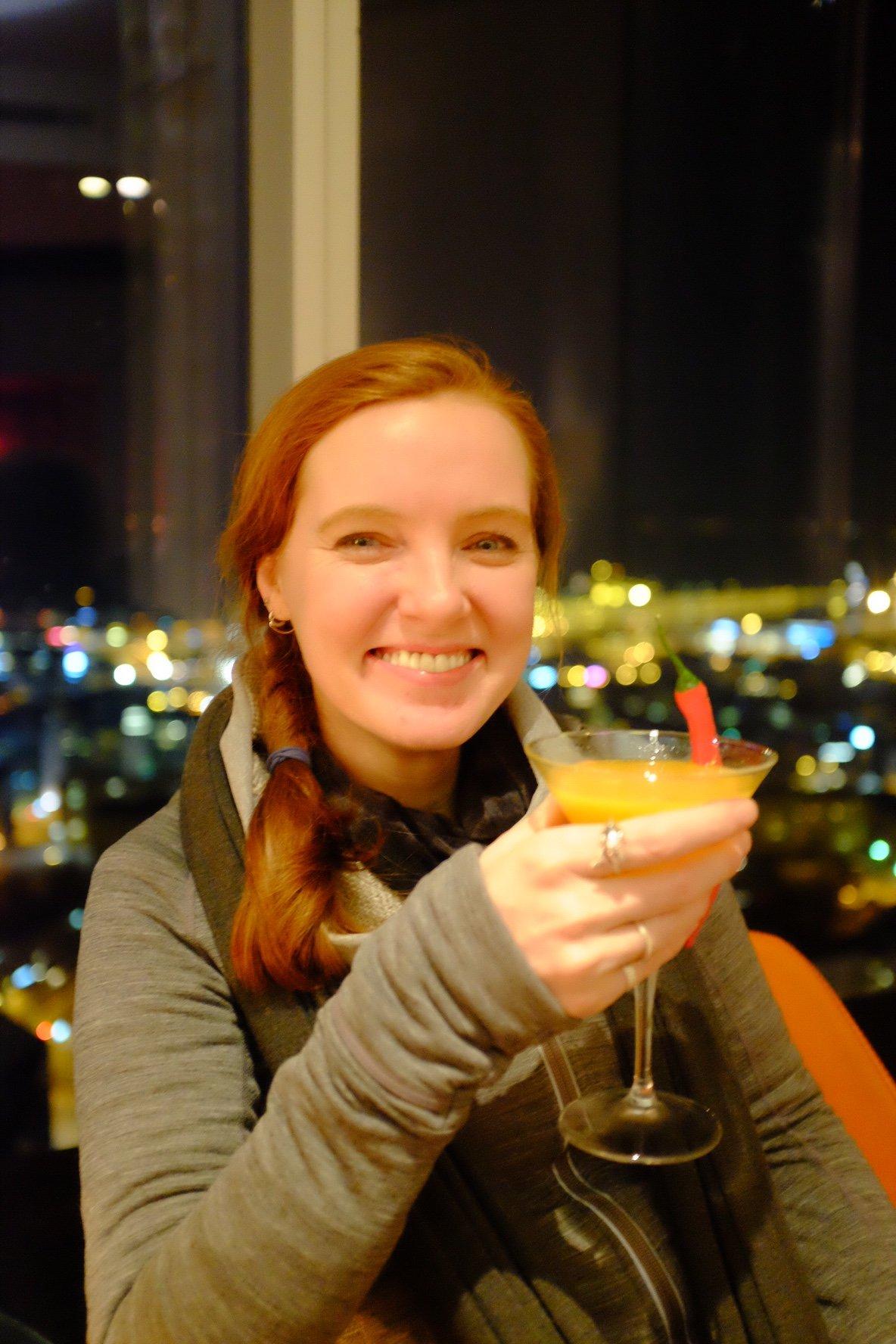 Sarah drinking a mango chilli coriander Cocktail at the Horisont Bar in Tallinn
