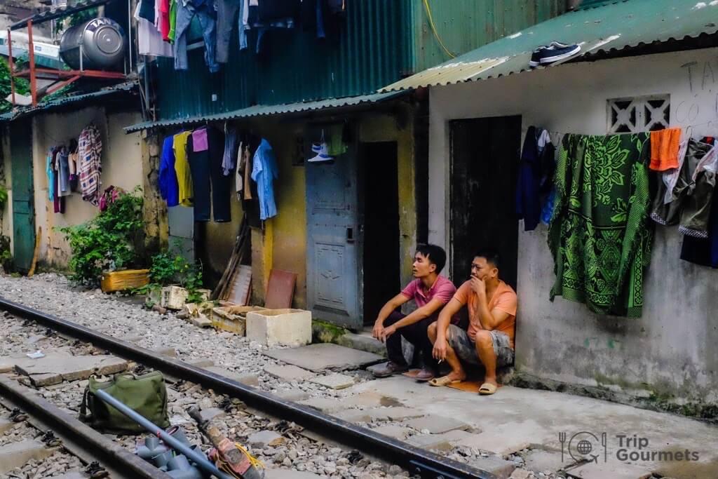 Hanoi train street two local men sitting