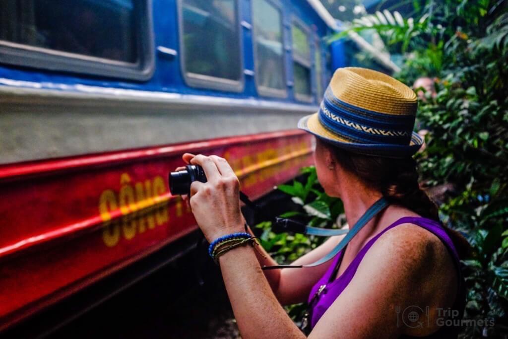 Hanoi train street woman with camera